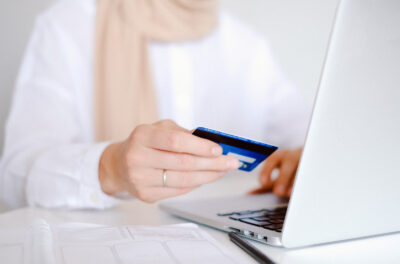 Canva-Person-in-White-Long-Sleeve-Shirt-Holding-Credit-Card